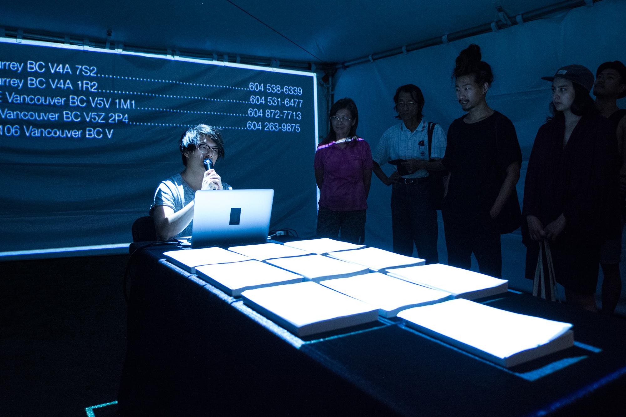 Milton Lim - whitepages, performance. Ash Tanasiychuk photo.